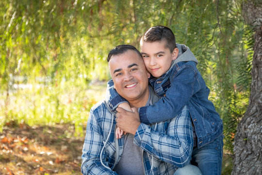 Portrait of Mixed Race Father And Son Having Fun Outdoors