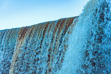 Close-up of a waterfall showing the smooth tumbling water.