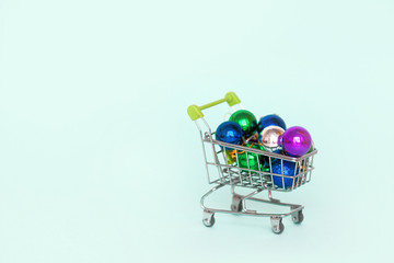 Shopping trolley,  Christmas ball Christmas and New Year shopping.