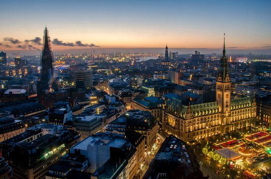 Hamburg at Christmas with the christmas market in the front of the town hall