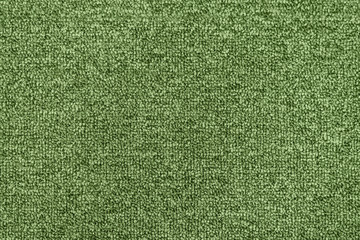 Seamless green generic carpet fabric pattern background texture.