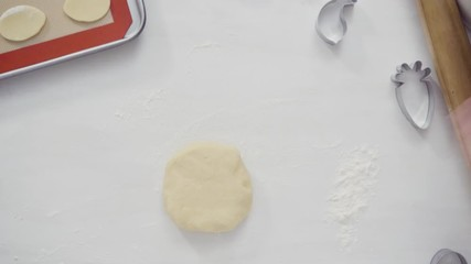 Wall Mural - Step by step. Flat lay. Rolling out Sugar cookie dough with French rolling pin.