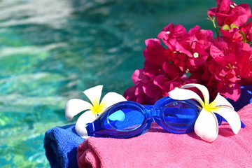 Fotobehang Carnaval A relaxing holiday at sea. Towels, glasses and flowers on the water. Beauty spa concept for body.