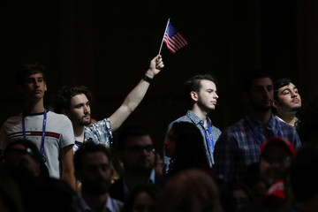 An audience member waves an American flag before a speech by U.S. President Trump in Hollywood, Florida