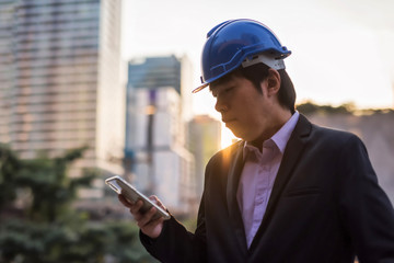 Businessman check project in smartphone in city