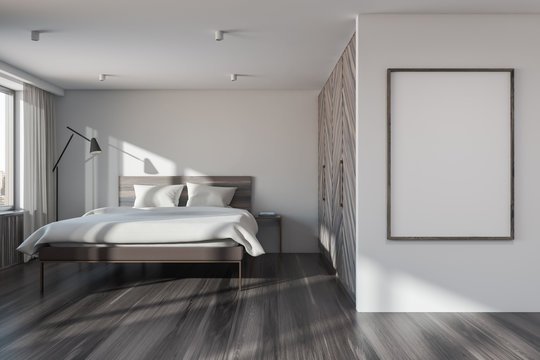White master bedroom with wardrobe and poster