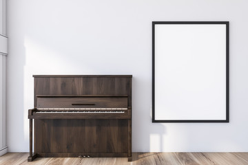 Wooden piano in white room with poster
