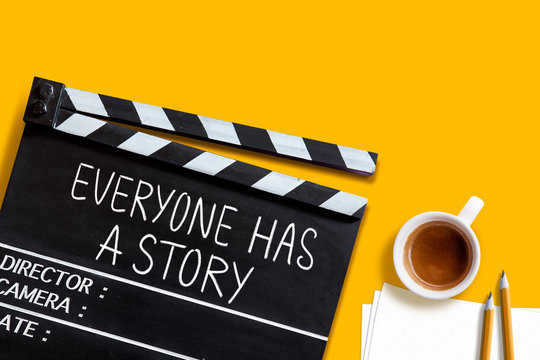 Everyone has a story.text title on movie clapper board  and coffee cup on yellow background