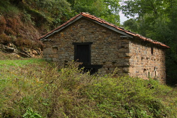 Old stone hut at the hiking track from Pido to Las Ilces in national park Picos de Europa in Cantabria,Spain,Europe