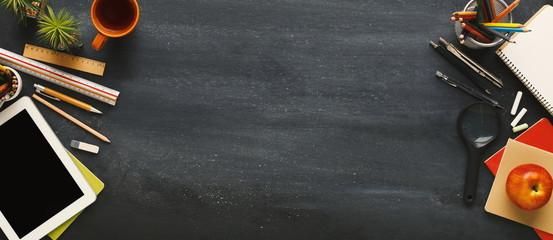 Supplies for school border on black chalkboard, panorama
