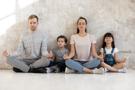 Mindful calm happy family of young parents and little kids.
