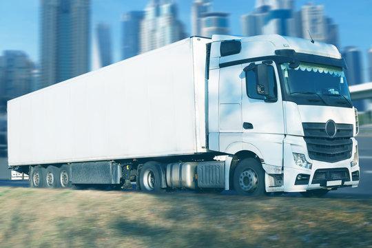 Big white truck vehicle going through city
