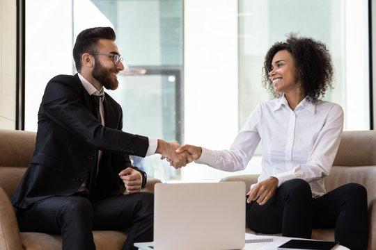 Multiracial business partners handshake get acquainted at meeting