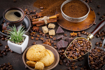 Canvas Prints Cafe Coffee grains on a table with accessories for coffee