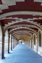 Arcaded sidewalk at the Place des Vosges in Paris - France