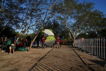 Asylum seekers' tent is relocated near the banks of the Rio Grande in Matamoros
