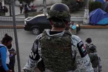 The Mexican National Guard patrols an encampment where asylum seekers live in Matamoros