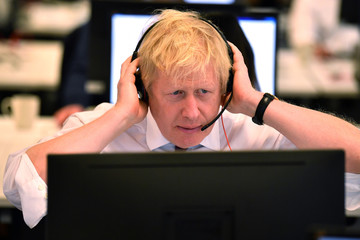 Britain's Prime Minister Boris Johnson speaks to a caller at the Conservative Campaign Headquarters Call Centre in central London