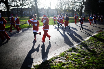 Competitors take part in the London Santa Run in Victoria Park, London
