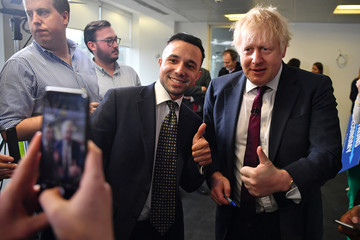 Britain's Prime Minister Boris Johnson poses for a photograph with a supporter at the Conservative Campaign Headquarters Call Centre in central London