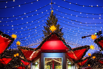 Traditional Christmas market in Europe, Cologne, Germany. Main town square with decorated tree and...