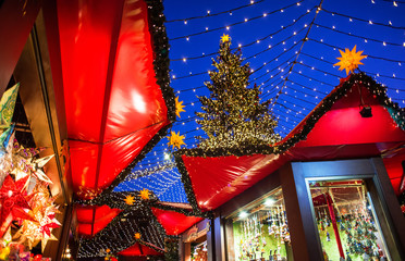Traditional Christmas market in Europe, Cologne, Germany. Main town square with decorated tree and lights. Christmas fair concept
