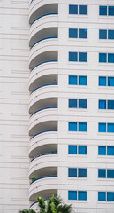 Fototapete - Curved Balconies on Modern Tropical Condo Tower