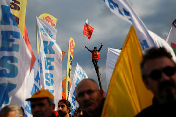 A demonstrator waves a flag during a protest against the economic policies of the government in Istanbul