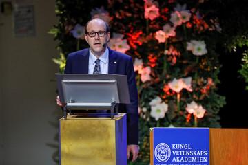 Economic Sciences Laureate Kremer speaks during his Nobel lecture at Stockholm University