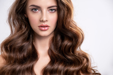 Portrait of a beautiful woman with a long brown hair.