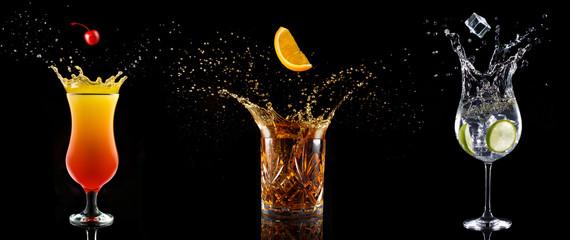 Foto op Plexiglas Alcohol set of cocktail glasses splashing on black background