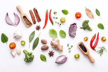 Aluminium Prints Grill / Barbecue Various fresh vegetables and herbs on white background.Ingredients for cooking concept sweet basil ,tomato ,garlic ,pepper and onion with flat lay..