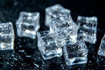 Fototapeta Ice cubes / melting ice cubes on black background, close up