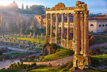 Papiers peints Rome Roman Forum in Rome, Italy. Antique structures with columns. Wrecks of ancient italian roman town. Sunrise above famous architectural landmark.