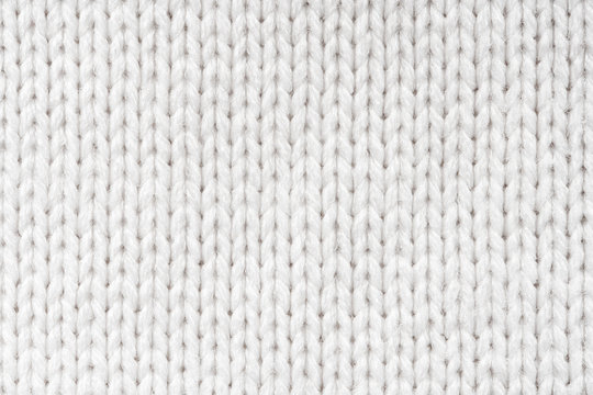 White Knit Fabric Background. Wool Sweater Texture Close Up