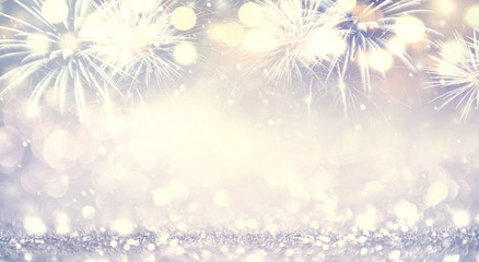 Fototapete - Fireworks and bokeh in New Year eve and Christmas, copy space. Abstract background holiday.