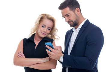 Young businessman showing information on smartphone to skeptic boss isolated