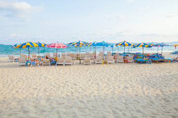 beach chairs and umbrellas on beautiful sea side place