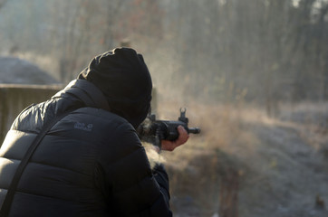 Man shooting at a target. Unformal shooting range near Kiev.
