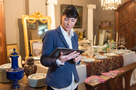 a woman in an antiques shop