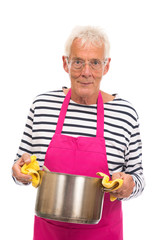 Houseman with pink apron and cooking pan