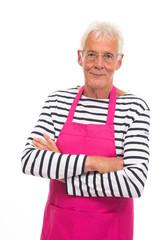 Senior man in pink apron