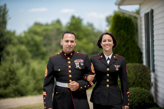 Shallow focus shot of a military couple looking at the camera