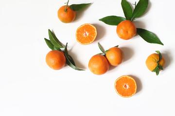 Styled stock photo. Decorative summer fruit composition. Whole and sliced orange tangerines, citrus...
