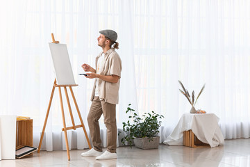 Young male artist working in studio Fotomurales