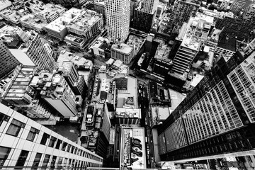 Fotobehang New York Aerial grey scale shot of the buildings and streets in New York City, United States