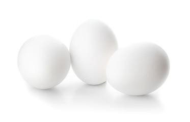 Fresh raw eggs on white background Fotomurales