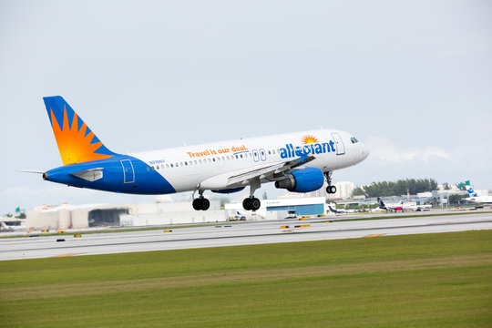 FORT LAUDERDALE, USA - JANUARY 26, 2016: An Allegiant Airlines Airbus A319 landing at the Fort Lauderdale/Hollywood International Airport.