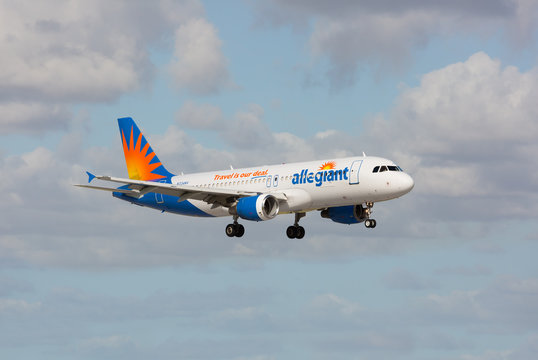 Fort Lauderdale, Florida - USA, January 14, 2017: An Allegiant Airlines Airbus A319 landing at the Fort Lauderdale/Hollywood International Airport.