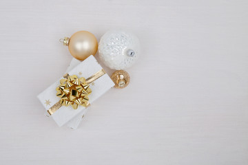 Christmas composition. Christmas gift boxes with Christmas balls on white background